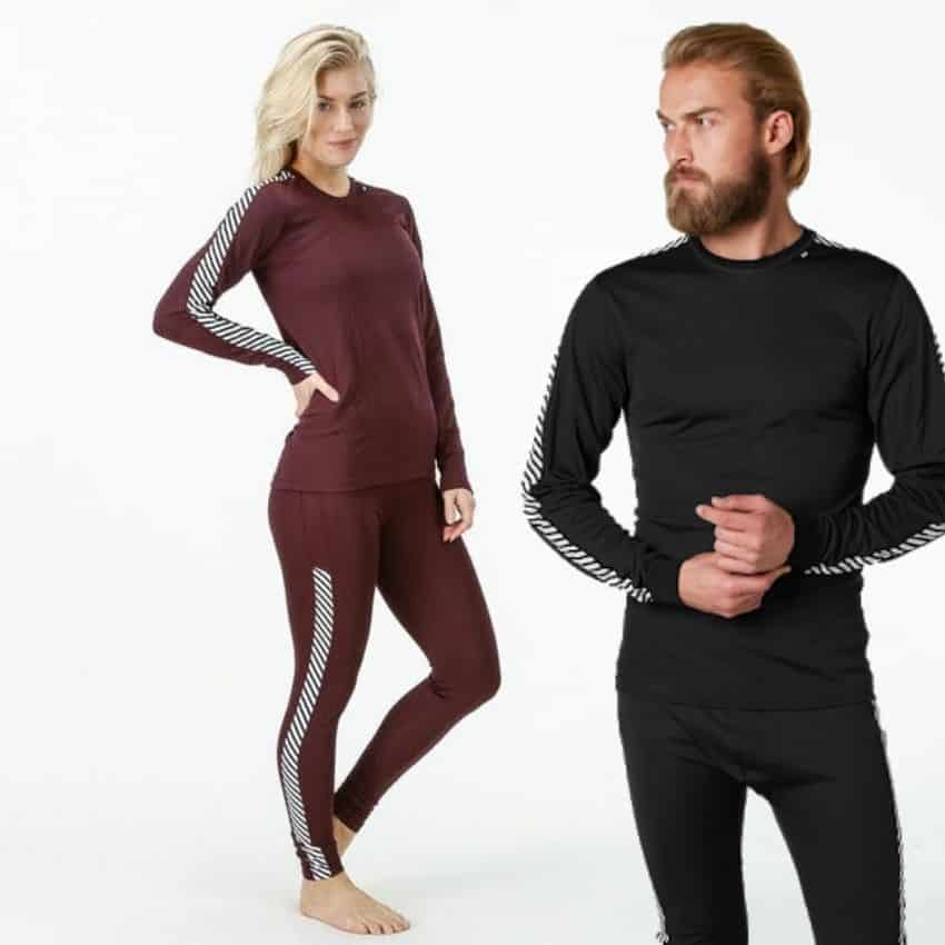 Mand og kvinde iført Helly hansen skiundertøj